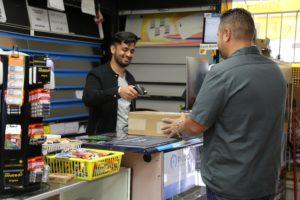 Cashier accepts parcel